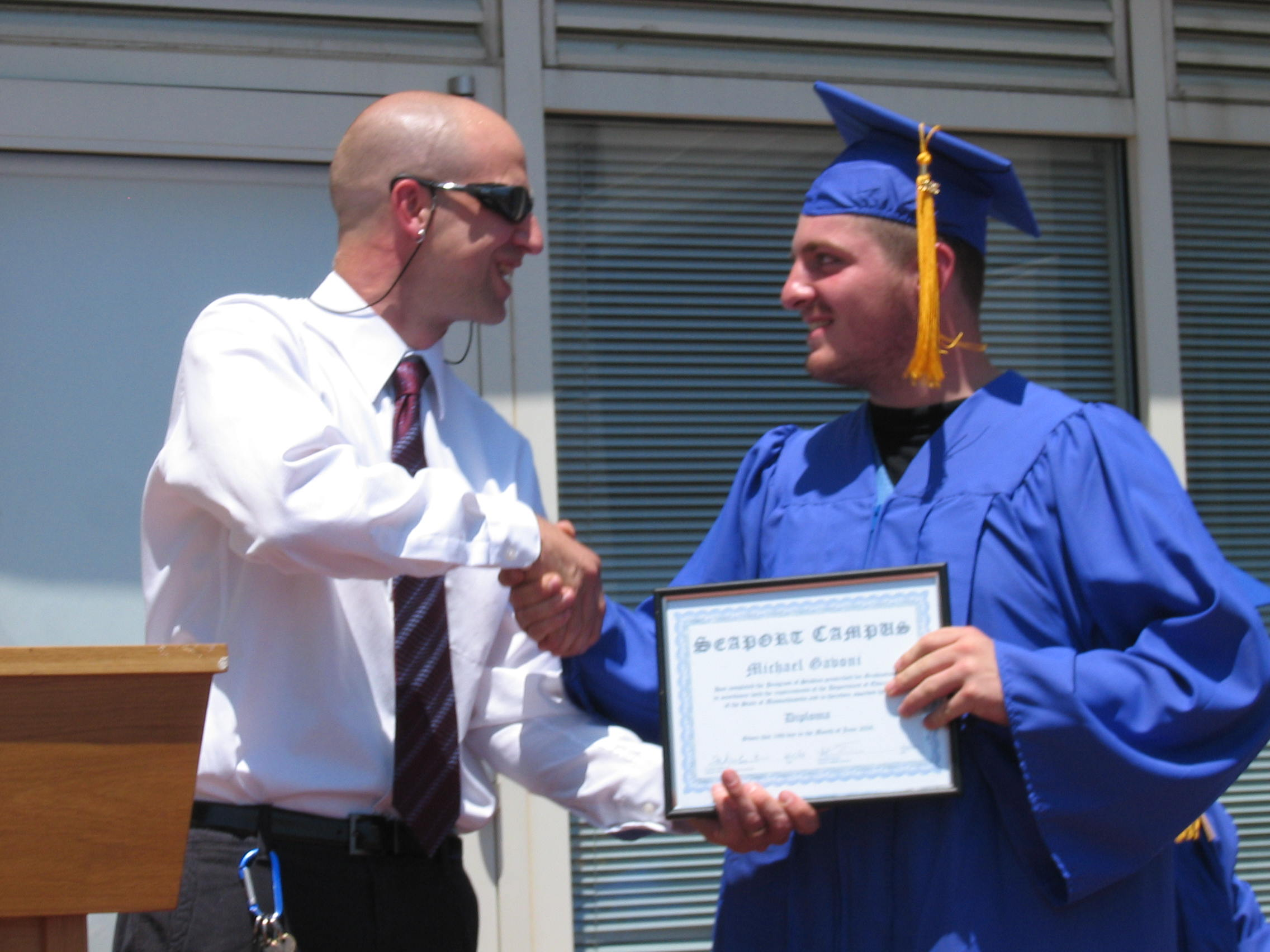 Giving a diploma to a student